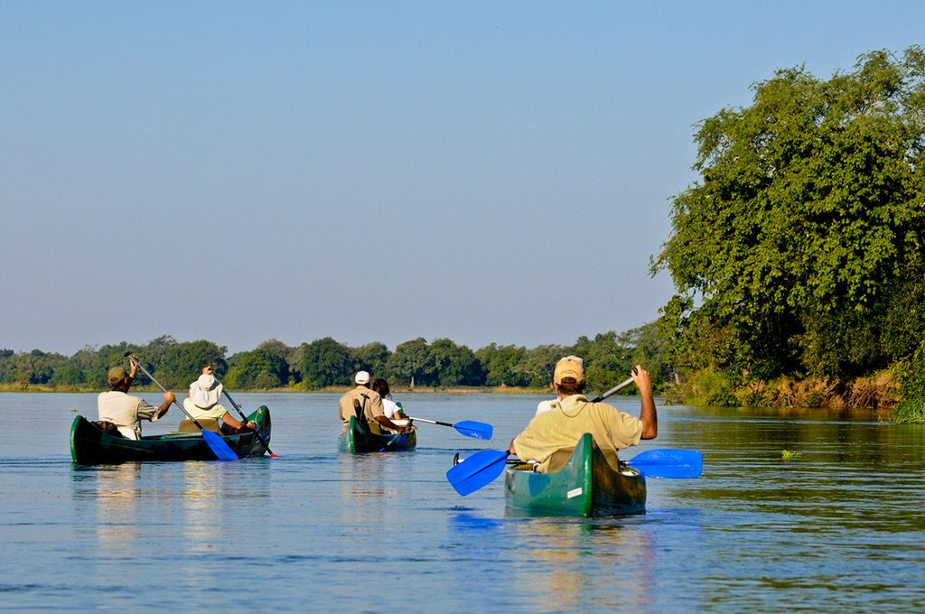 People in canoes on the Zambezi River
