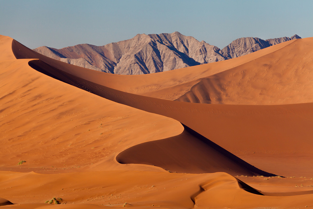 View to sand dunes and mountains at the famous landmark Sossusvlei, Namib Desert, Namib Naukluft Park, Namibia