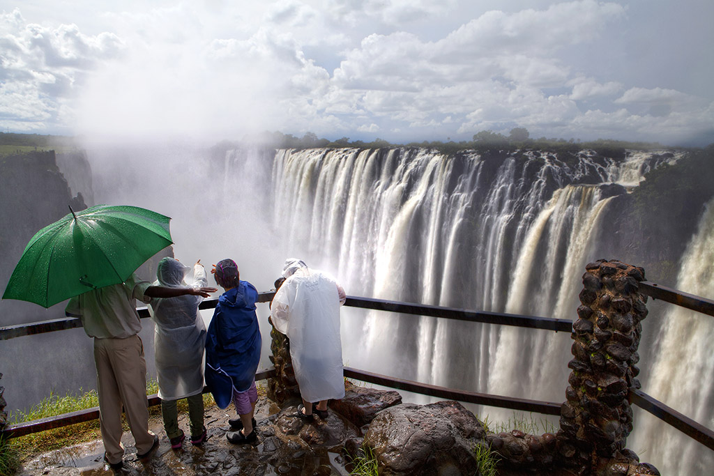 The Wet Victoria Falls with tourists in raincoats