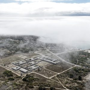 Mist envelopes Robben Island and the famous prison that once held Nelson Mandela and other political prisoners incarcerated during the Apartheid era. Mandela spent 27 years on the island as a political prisoner and quarry worker before being released to become the first democratic president of South Africa.