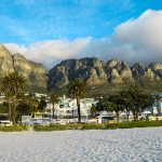 Where most beaches require taking pictures towards the water, this phenomenal place is gorgeous all around. Mountains, boulders, palm trees and beautiful cliffs surround Camps Bay beach.