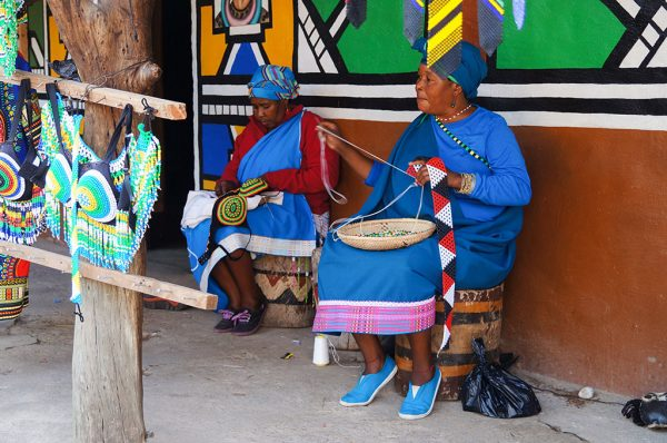 Lesedi Cultural Village, South Africa: African women making souvenirs from colorful beads for sell at Lesedi Cultural Village,South Africa.